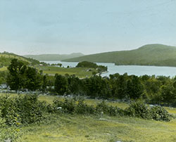 View looking northeast across Schoon Lake at the narrows in the Adirondack Mountains. 1912
