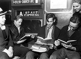 New York City High school boys reading on Eighth Avenue subway express.1934