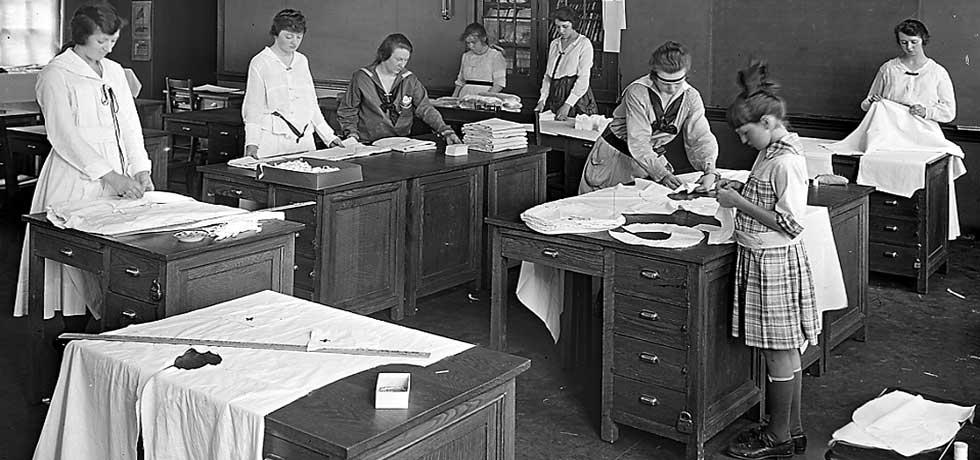 Household Arts. School girls creasing yokes and examining and folding finished shirts. Vocational School, Troy, N.Y. August 1917