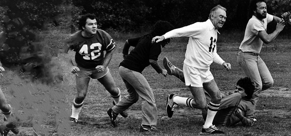 Image. The Pumpkin Bowl, an annual football game featuring Governor Carey and his staff