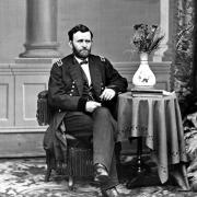 General Ulysses S. Grant seated at table