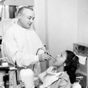 Thomas Indian School Photograph. Oral Hygiene: Girl Examined by Dentist