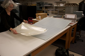 Provide adequate space and support when handling oversize materials. NY State Archives, Albany, NY.